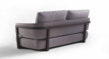 Arena sofa from Porada, showing the exposed wood frame
