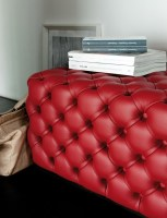 Alcide ottoman in red leather
