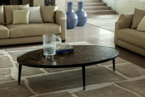 Bigne oval coffee table with dark marble top.