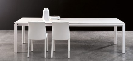 Chat table with two extensions, in white.