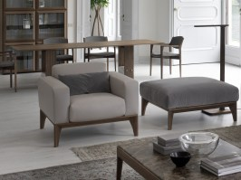 Fellow Poltrona shown with contrasting footstool and cushion