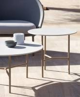 Grada outdoor tables with 109 champagne frame and 300 white Trespa top