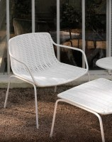 Lounge chair in white with foot stool