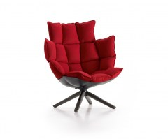 Husk armchair with snug sides and headrest