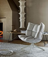 Husk armchair with snug sides