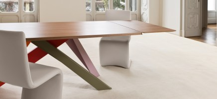 BIG table with colour legs and wood top, showing extension.