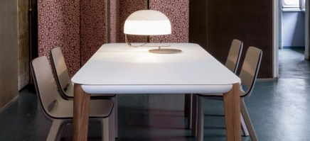 The Match table with white glass top and natural wood legs.