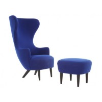 Wingback armchair in blue with black legs and ottoman